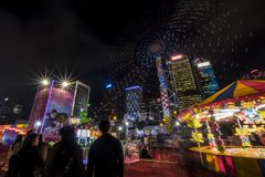 People playing games in a large carnival in the heart of financial center of Asia. Royalty Free Stock Photography