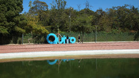 People playing in giant letters forming the word QUITO in the La Carolina Park in the north of the city of Quito Royalty Free Stock Image