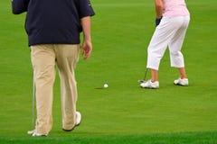 People playing golf Stock Photos