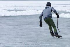 People playing hockey on frozen lake Stock Image
