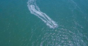 People are playing a jet ski in the sea. Aerial view royalty free stock image