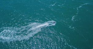 People are playing a jet ski in the sea. Aerial view stock photos
