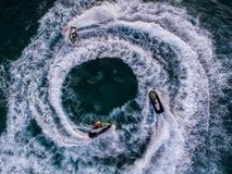 People are playing a jet ski in the sea.Aerial view. Top view.am. Azing nature background.The color of the water and beautifully bright. Fresh freedom. Adventure Royalty Free Stock Photo