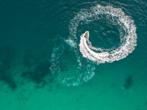 People are playing a jet ski in the sea.Aerial view. Top view.am. Azing nature background.The color of the water and beautifully bright. Fresh freedom. Adventure Stock Photos