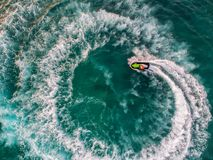 People are playing a jet ski in the sea.Aerial view. Top view.am. Azing nature background.The color of the water and beautifully bright. Fresh freedom. Adventure Royalty Free Stock Photos
