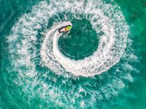 People are playing a jet ski in the sea.Aerial view. Top view.am. Azing nature background.The color of the water and beautifully bright. Fresh freedom. Adventure Stock Photography