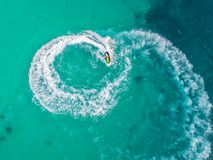 People are playing a jet ski in the sea.Aerial view. Top view.am. Azing nature background.The color of the water and beautifully bright. Fresh freedom. Adventure Stock Image