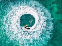 People are playing a jet ski in the sea.Aerial view. Top view.am. Azing nature background.The color of the water and beautifully bright. Fresh freedom. Adventure Stock Images