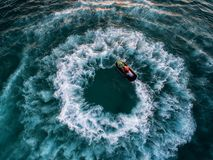 People are playing a jet ski in the sea.Aerial view. Top view.am. Azing nature background.The color of the water and beautifully bright. Fresh freedom. Adventure Royalty Free Stock Images
