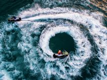 People are playing a jet ski in the sea.Aerial view. Top view.am. Azing nature background.The color of the water and beautifully bright. Fresh freedom. Adventure Stock Photo
