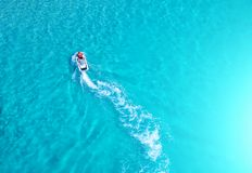 People are playing a jet ski in the sea.Aerial view. Top view.am Royalty Free Stock Image