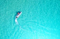 People are playing a jet ski in the sea.Aerial view. Top view.am Stock Photography