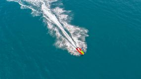 People are playing jet ski at sea during the holidays. Aerial vi stock photo
