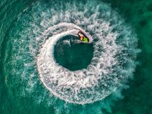 People are playing jet ski at sea during the holidays. And beaut Royalty Free Stock Photos