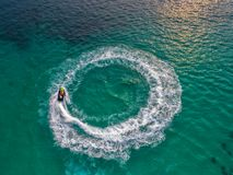 People are playing jet ski at sea during the holidays. And beaut Royalty Free Stock Photo