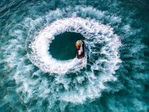 People are playing jet ski at sea during the holidays. Royalty Free Stock Photos