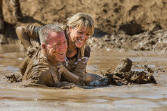 People playing in the mud together Royalty Free Stock Photography