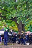 People playing music in  Aarhus city. Beautiful sight in Aarhus,Denmark ,people playing music under a big tree,a band Royalty Free Stock Photo