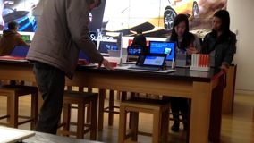 People playing new computer at Microsoft store Royalty Free Stock Photography