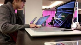 People playing new computer at Microsoft store