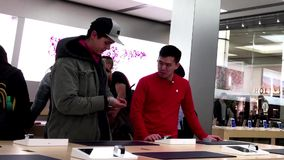 People playing new iwatch inside Apple store. In Burnaby BC Canada stock footage