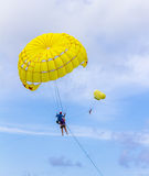 The people playing parachute. Stock Image