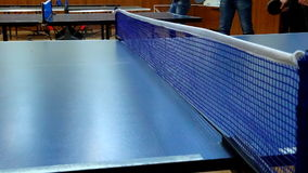People playing ping pong. Timelapse. Timelapse of people playing ping pong in sports room stock video footage