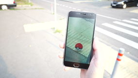 People playing Pokemon GO application the hit augmented reality smart phone app while trying to find Pokemon. stock video