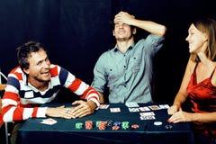 People playing poker Stock Photos