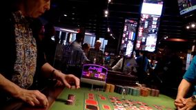 People playing roulette in casino stock video footage