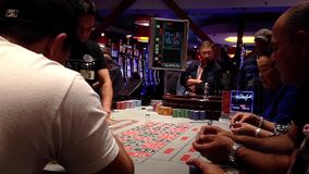 People playing roulette in casino stock video