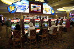 People playing slot machines Stock Image