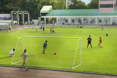 People playing soccer at a high school Royalty Free Stock Images