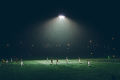 People Playing Soccer during Nighttime Royalty Free Stock Photos