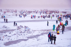 People playing on Songhua River. This is a winter scenery which in Haerbin city of china this winter.People are playing on Songhua River which was freeze-up Stock Photo