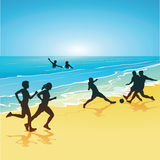 People playing sports on a beach. Silhouetted people figures running, playing soccer or football, or swimming at a summer beach Royalty Free Stock Photos