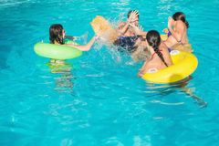People playing in the swimming pool Stock Images