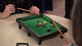 People playing table billiard stock video