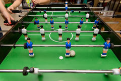 People playing in table football Stock Photos