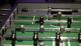 People playing table football. Indoors stock footage