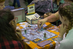 People playing table game at the Gamefilmexpo festival Royalty Free Stock Photos