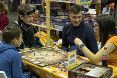 People playing table game at the Gamefilmexpo festival Royalty Free Stock Photography