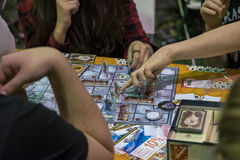 People playing table game at the Gamefilmexpo festival Royalty Free Stock Photo