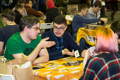 People playing table game at the Gamefilmexpo festival Royalty Free Stock Image