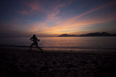 People playing taiji at beach. In sunset Stock Photography