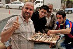 People playing traditional board game, Arbil, Autonomous Kurdistan, Iraq Royalty Free Stock Photo