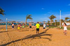 People playing valleyball on the tropical beach. HURGHADA, EGYPT - APR 9, 2013: People playing valleyball on the tropical beach in Hurghada. Hurghada is one of Stock Photos