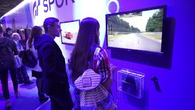 People playing video games on PlayStation PS4. Moscow, Russia - October, 2016: IgroMir Expo 2016 and Comic Con Russia 2016 in Moscow, Russia. People playing stock video