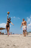 People playing volleyball on the beach Royalty Free Stock Image
