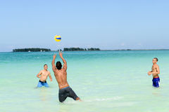 People playing volleyball in clear water of Cayo Guillermo beach Royalty Free Stock Image